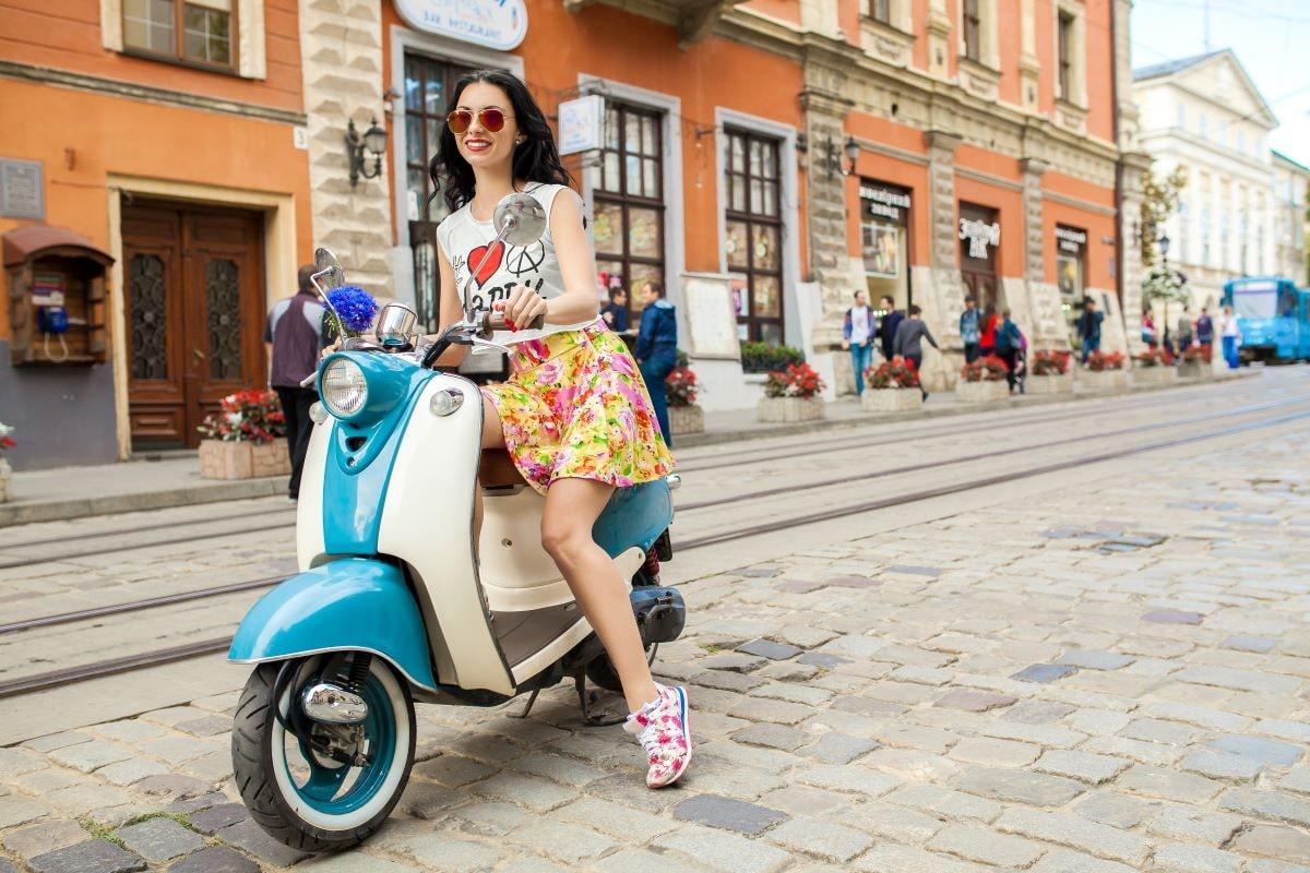 woman riding motorbike italy